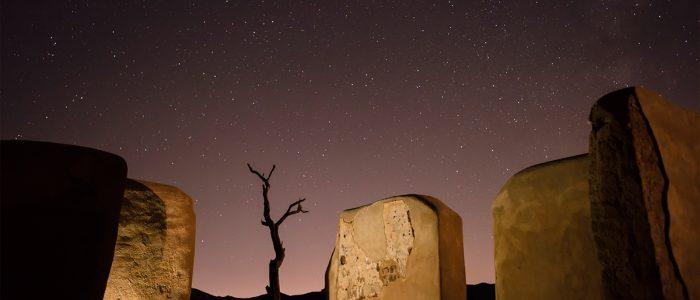 A Glimpse of Nightime View with Huge Rocks and Stars at Twentynine Palms, CA